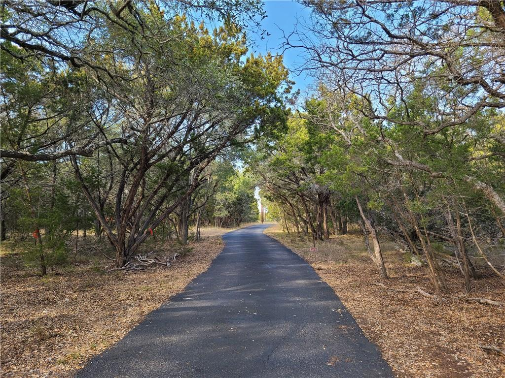 Large, level tract of land in Leander. Home on property. Seasonal creek. Property sits at the end of the road. Septic, well, and utilities connected.