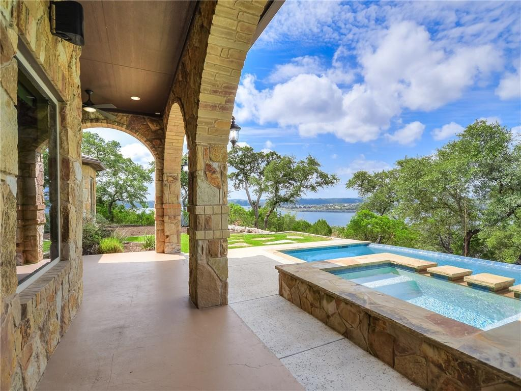 9.26 acres perched on a beautiful hilltop overlooking Lake Travis with panoramic views, this gated custom single-story home offers the perfect escape. Gracious entertaining areas, 4 beds, 3.5 baths, office and flex/exercise space. Inviting primary suite with lake views, sizable walk-in closet, double vanity, separate shower and tub. Outdoor entertaining space features spectacular pool with stunning lake views and grill/kitchen area. The property is equipped with solar panels, 3-car garage and 2 wells.
