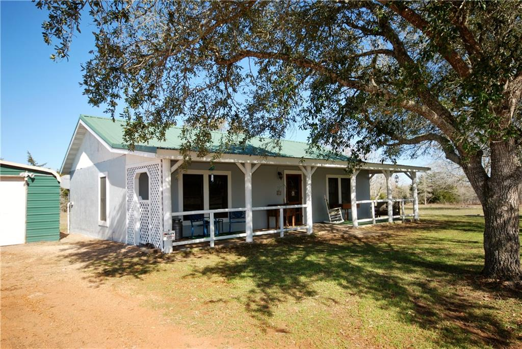 Wouldn't you like to be out in the country with room to roam? 20-acre property has a 1,104 SF updated country home/cabin with 2 BR/1B. This property has much to offer! Enjoy relaxing and watching sunsets while sitting on the large front porch. The open concept kitchen, dining, family area has exposed beams which give a comfortable Farm & Ranch feel. 2019 updates include: New CH/AC, energy-efficient Andersen windows, new vinyl flooring in most areas, water heater, water softener, tiled walk-in shower and free-standing bathtub. Kitchen has new granite counter tops, charcoal-colored sink. On the west end of the house are 15-amp, 50-amp and 30- amp plugins for RV hook up. Additionally, there is a 22' x 30' metal drive-through garage.  There is a water well and septic tank on the property. The driveway to home has recently been topped. ¾ heavily wooded with a mixture of hardwoods making a great haven for wildlife like deer, wild hogs and turkeys and holds an agriculture exemption!
