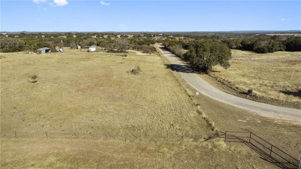 10 Acres in Hye TX PRIME LOCATION!!! 10 UNRESTRICTED Acres located less than a 1/4 mile off of HWY 290 in Hye TX.  The property offers approx. 700 ft. of frontage on paved Rocky Rd.  There is power and a great water well on-site. The improvements consist of great perimeter and cross fencing, a manufactured home that is in need of some renovating, a barn/workshop, Septic system, and RV Hookups.  Some of the land has been cleared of cedar and some has been left natural.  This property offers great potential for several different uses.  Located in the Heart of the Texas Wine Trail.