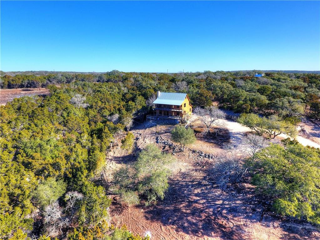 Spectacular tract with no restrictions.  Older 3/3.5 multi story home and 2/1 guest house/cabin.  Property has NO restrictions.  Incredible views from the north part of the property looking out over the Wimberley valley, would make a spectacular homesite or cabin rental sites.  Neat wet weather creek starts on the property.
