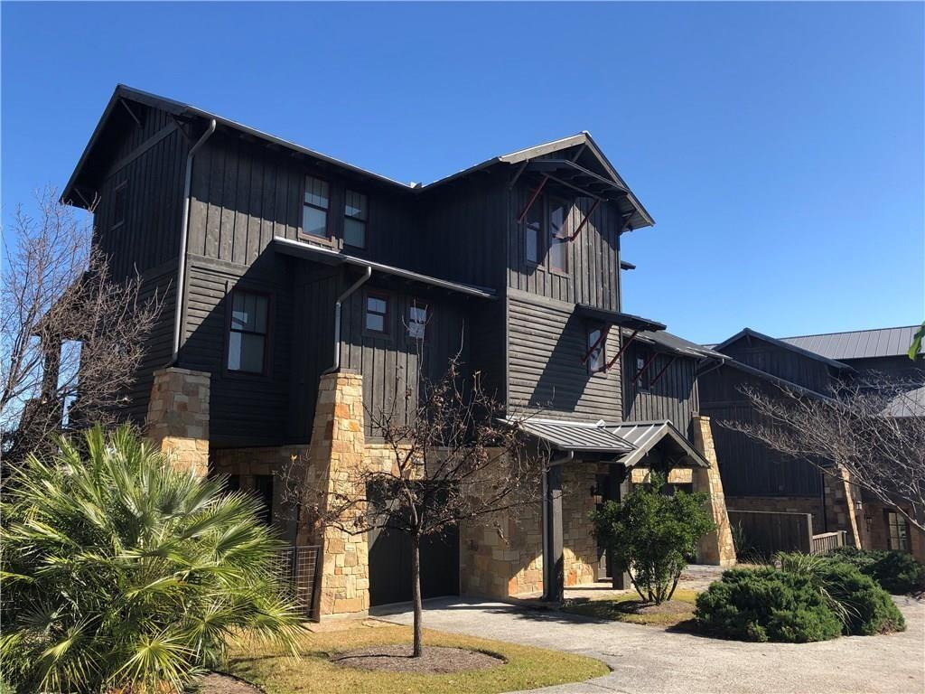 One of only 3 units overlooking the Lazy River/Swim Park/Bar with AWESOME views of Lake Travis! This unit is also one of the few out of the flood zone - FULLY FURNISHED + GOLF CART + ICE MAKER - 5 bed/4.5 bath w/covered patio-2 balconies off main floor - Open Floor Plan with kitchen/dining/all beds w/lake view - 1st floor boasts a bedroom with bunk beds - living room - TV area - reading area - great for the kiddos to have their own space and it opens to the backyard which is equipped w/a built in grill.  Boat and Boat slip available - ask agent for details.