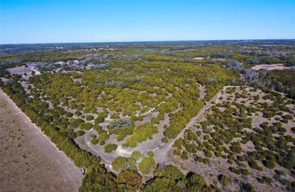 Located in the Texas Hill Country at the end of a county road, with no restrictions, this tract of land has endless opportunities. The land has an abundance of Heritage Oaks, and a light amount of Pecans in the back of the property. The San Gabriel river is wrapped around the outside of the property, and the views of Balcones Springs are sure to capture all the best qualities of the Texas Hill Country. Well hit vigorous 60 gallon a minute water flow at roughly 330 ft. down. Two sides of the 10 acre tract acres is fenced in, and NOT located in a flood plain. Large ranches surround the property. Private gate and drive will be put in place once the land is under contract. Each tract will have their own driveway, so there will be no easements created and shared. Easily accessible, but provides complete seclusion, and privacy. 40 Minutes to Austin, 12 minutes to nearest grocery store, hospital, gas station, and post office. 