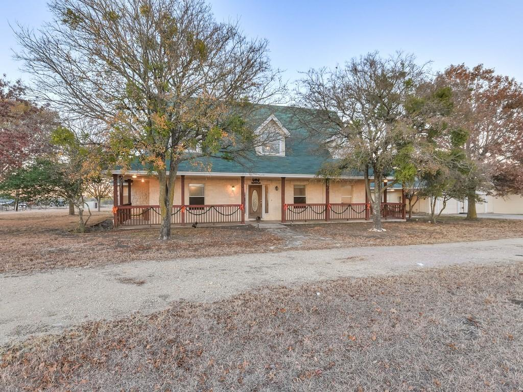 This beautiful country home has acreage that boasts a unique charm in a tranquil neighborhood. Offers an open and
