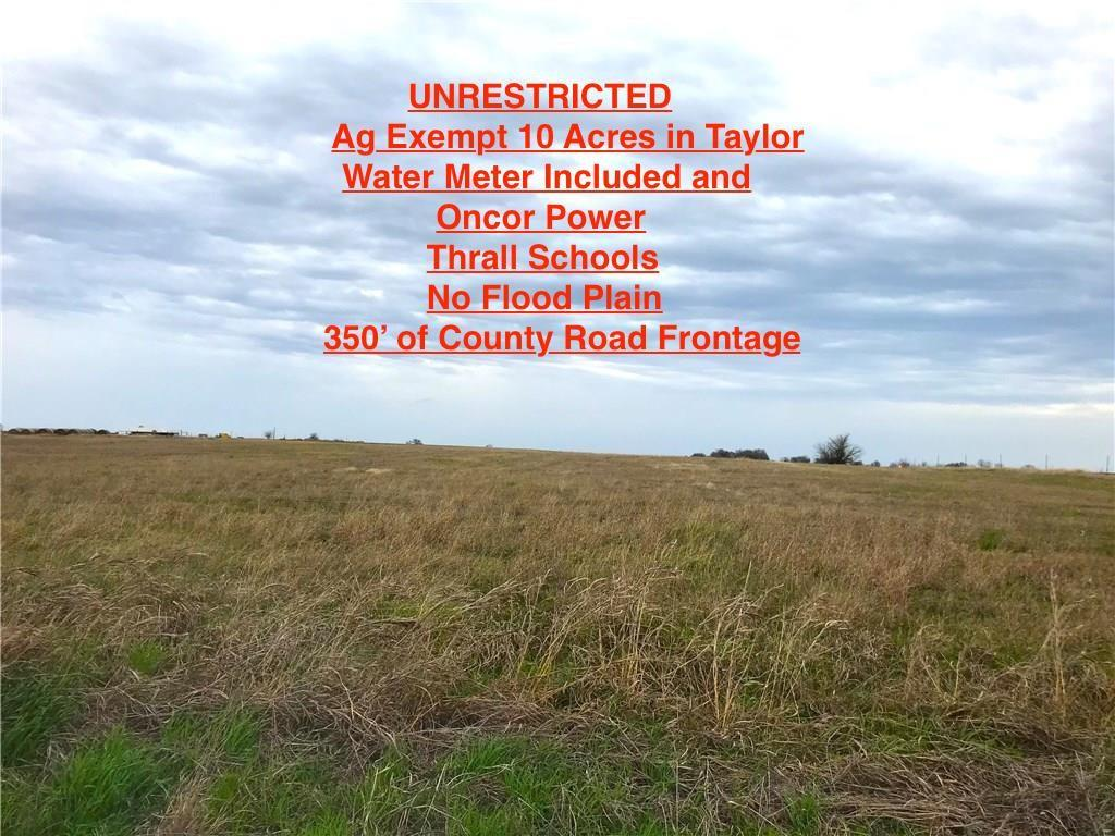 Unrestricted, 10 acres (more land available), an agricultural exemption in place, water meter included, and Oncor power being installed to the site now.  No floodplain. Flat level with good views, 350' of county road frontage.