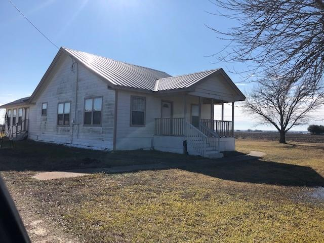 GREAT SMALL FARM.  EXCELLENT INVESTMENT.  GOOD FLAT LAND. CORNER ROAD FRONTAGE. 5 MINS TO HWY 290.  10 MINS TO MANOR. 10 MINUTES TO ELGIN.  20 MINUTES TO AUSTIN.  CUTE FARM HOUSE WITH LRG COVERED REAR PORCH, VIEWS OF SURROUNDING FARMS.  DETACHED 2 CAR GARAGE W EXTRA STORAGE.  SEE DOCS FOR APPRAISAL AND OWNERS PREFERENCES.  TWO TAX ID #S, 248204, 547360 ABRAHAMSON CT MAINTAINED BY NEIGHBOR AND SHARED EXPENSES.