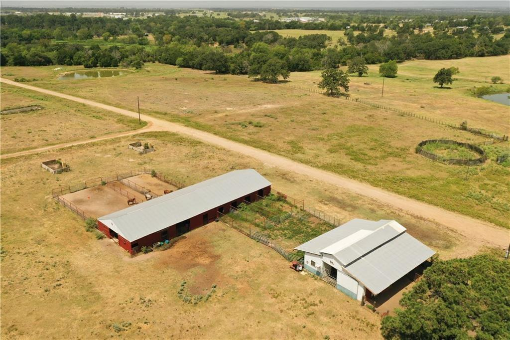 41.5 acre horse ranch with 2000+ sq ft brick main house, a double wide that produces $1100 per month in rental income, 600 sq ft two story tack room/living quarters, large horse training arena that is newly built and 2 large barns with stables that have automatic water valves for livestock. Barn has living quarters. Property has a water well, and water meter. This property sits just a few minutes from Bastrop or Elgin making for an easy commute to Austin.