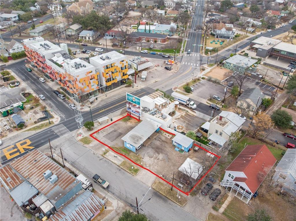 Commercial opportunity 4 blocks east of I35 on a .20 acre lot located at the corner of East 11th Street and Lydia Street. Zoned as CS-1-NCCD-NP.  Currently leases in place: car wash business and commercial sign placement (through 2027)
