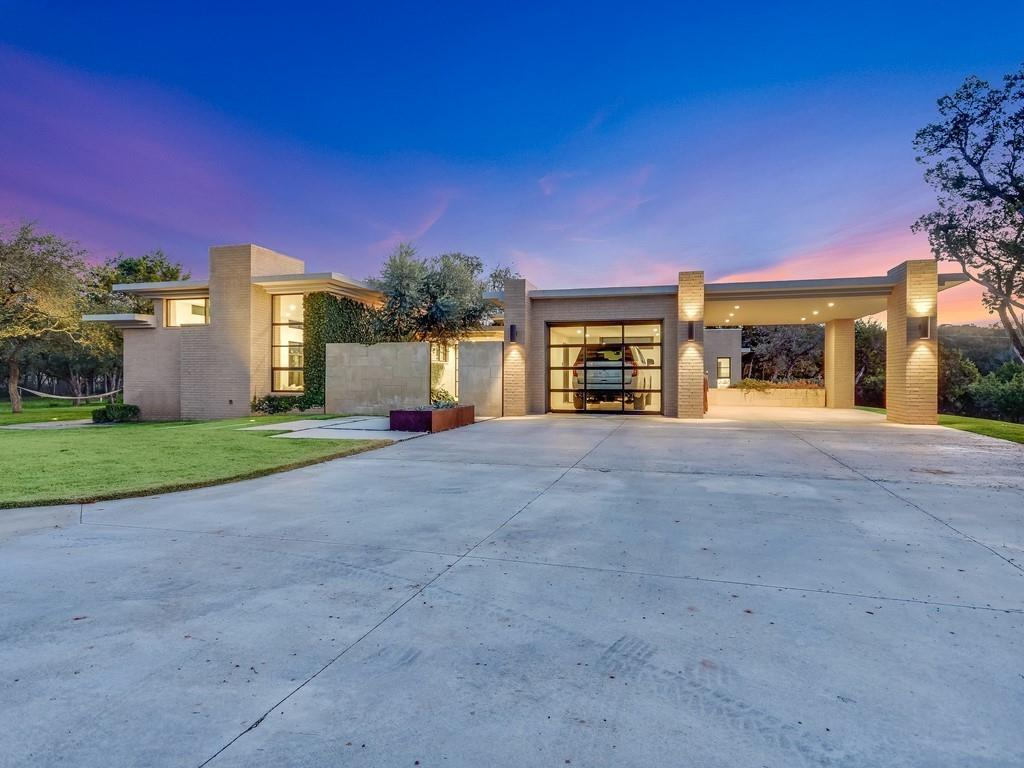 This tranquil Dripping Springs property offers the ultimate escape from the city. Fully-fenced and gated, the private compound features a main residence, a guest casita, and incredible outdoor living/entertaining spaces. Modern architectural details and a neutral palette complement the surrounding beauty. Walls of framed casement windows flood the interior with light and frame views of a grove of live oaks. The main residence and the guest casita offer designer kitchens and open-plan living. A serene master sanctuary includes a spa bath with an outdoor shower. Spanning over 6 acres, the property blends pristine countryside and landscape architecture featuring drought-tolerant plants, hardscape paths, and metal planters. A mature kitchen garden, chicken coop, 2-stable barn, and air-conditioned workshop bring your sophisticated Hill Country lifestyle into focus only 20 minutes from Austin. And just 15 minutes from Dripping Springs and Bee Cave.