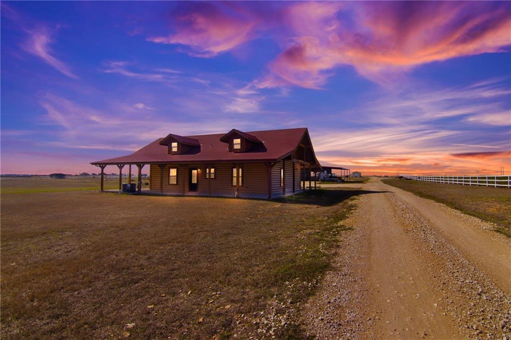 County living at its best with 21 acres of unrestricted land, ag exempt, and no HOA.  Beautiful custom built, fully furnished log home with Colorado spruce logs featuring two bedrooms and one full bath approx 1352 sqft.  Stainless kitchen applicances with granite counter tops and breakfast bar all open to the dining and living area.  Wrap around covered porch with captivating views of open pasture.  Detached air conditioned/heated workshop that with a little effort could be made into additional living quarters.  Three bedroom, two full bath manufactured home sits at the back of the property with fenced in back yard, perfect for a guest house approx 1600 sqft.  Bring your horses and be amazed!  Property includes 21 horse stalls, multiple paddocks, covered riding pen, and open pasture.  No expense was spared making this a one of a kind property.  Inside the main barn is an office, one bedroom and full bath ideal for onsite helper.  Great location just outside of Georgetown to have space and privacy but close enough to town.  It is located just 7 miles to the downtown Georgetown square, 9 miles to HEB & 10 miles to St. Davids Hospital.  Plus, toll 130 will get you to Austin Bergstrom Airport in less and an hour.  Commercial potential with short term rental of log home and horse boarding, ask agent for details.  This property is a must see with plenty of open land to build and add onto.
