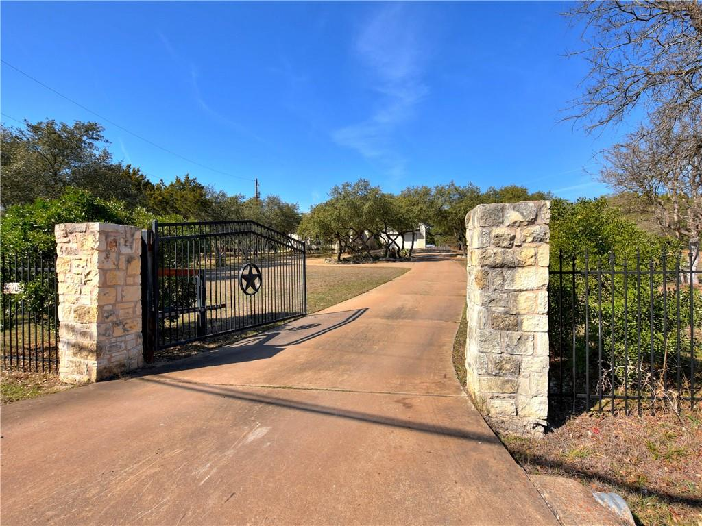 Rare Home Estate on Hudson Bend that includes 3 subdivided lots zoned residential SF2, over 2.15 acres.  Can build 2 more homes, sell extra lots or keep them for privacy & space.  No HOA, away from the city noise and congestion at Lake Travis, minutes to everything. Gated entrance is open for easy show day or evenings. Water District #17, LCRA septic
