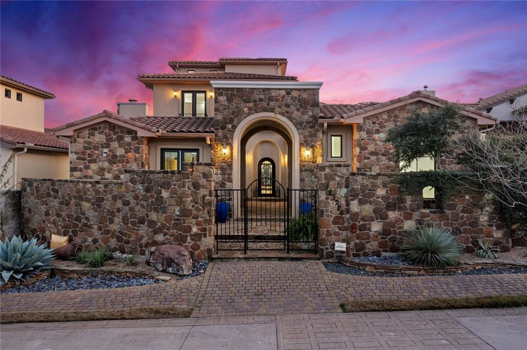 Enjoy exceptional hilltop living over Lake Travis in this beautifully updated Mediterranean-style home in the upscale gated community of Villa Montana! Feel transported to a European vacation destination, yet conveniently located for a quick trip downtown. You enter through a beautiful courtyard on the first floor, where you will find a private detached casita to the left and an arched metal front door that opens to the formal dining and living areas. Built for entertaining and relaxing, this amazing three-story home features a functional floor plan with stunning architecture, spacious rooms, high ceilings, wall of windows, fresh paint throughout, brand new ACs, upgrades galore and amazing views. The waterfall island, all new lighting fixtures and Taj Mahal quartzite countertops will certainly be a point of conversation. The luxurious master suite is conveniently located on the main floor featuring solid Ash hardwoods, Calacatta counters and seamless glass shower. The hardwoods continue moving upstairs where you will find the spacious game room, two additional guest rooms and a covered patio. Going up to the 3rd level, you will find an exercise room/study and a large open balcony with breathtaking panoramic views of the Texas hill country. Convenient to 620/2222, Lakeway, Steiner Ranch and Four Points retail and restaurants, and quick access to downtown Austin. Enjoy hill country luxury living within the acclaimed Leander ISD. Visit http://bit.ly/13204VillaMontanaTour for a video walkthrough.