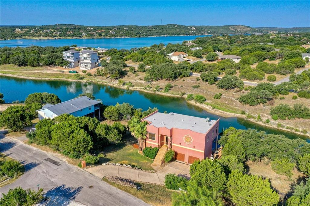 This is a great home to work from and to entertain in.  Many Decks double your living area, Guest love having breakfast or coffee on the Main Deck, The entrance waterfall adds to the ambiance of Living like your in the Tropics.  4 Bedrooms gives you the flexibility for home office.  This luxurious waterfront multilevel home on Lake Travis features a Dock, Pool, Spa, and 1750 sq ft of outdoor living space.  Grand entry with a waterfall then opens up to large Family room Dining area and Den Many windows with big Lake and Hill Country Views.  The kitchen features built-in stainless appliances, granite countertops, and large tile flooring.  Huge master suite with custom ceiling, large windows, and balcony with super Lake views, many built-in separate vanities with walk-in shower and a jetted tub.    FAQ on our House:  The Lake:  Lake Travis is the main water reserve on the Colorado River chain, the water levels fluctuate.  Right now we are 10 feet below average water level and 23 feet below full. The dock grounded around Thanksgiving.  This is only the 2nd time this has happened since we lived here. The previous time, in 2018, the water went down in August and came back in October. The dock is wet at 660 mean sea level, floats around 662 msl.  We are currently at 658 msl.  (we are a good rain storm in the Hill Country from having water again.)  Normal rain seasons are May and October When full, the water is about 21 feet deep by the dock. For more information on the lake levels see https://hydromet.lcra.org/riverreport  For pictures of what the lake looks like full, see the slideshow on the TVs  Thank you so much for your interest in our home.  We hope you love it as much as we have!!