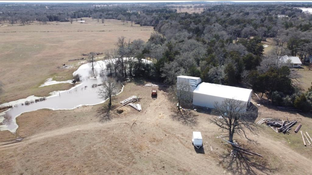 Beautiful 28.989 acres with over 500' of Highway 290 frontage. Conveniently located  just outside the city of Giddings. This property has a brand new metal building. This property also hosts 2 ponds, medium/large trees, open pasture and is fully fenced. Agricultural exemption is in place.