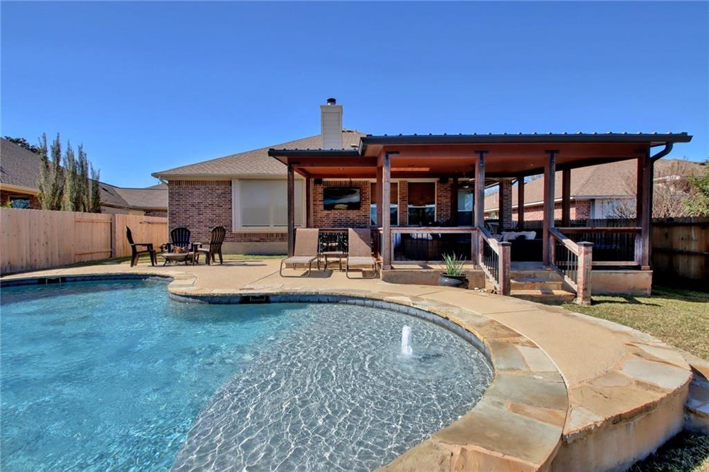 4 bedrooms, or 3 with a designated study, formal dining & breakfast area, island kitchen with ample storage, gas cooktop, built-in oven & microwave. This 1 story home has a large covered flagstone patio with recessed lighting & ceiling fans, plumbed for gas grill connection, wired for TV & surround sound. Swimming pool for hot Texas summers! Backs to a native green belt for enjoying the morning sunrise. No neighbors behind. Two car garage + 1/2 space for storage or work space. This neighborhood feeds into exemplary RRISD, England Elem, Pearson Ranch Middle, McNeil HS. Located just up the road from Apple Campus.