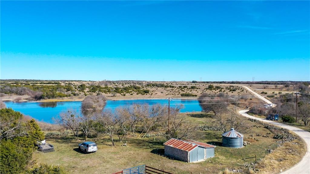 163 acre property located less than a 1/2 off HWY 281 on CR 3500. 3 total ponds . 1 HUGE pond which is spring fed, and stocked with catfish and bass. Spring runs from the neighboring property onto this property through it's beautiful ravine. Deer lease and cattle lease makes for the perfect ag exempt property. Come see the abundance of wild life and many possibilities this land has to offer. City water is not too far away. Cross fencing for small cattle operation. 3,000 gallon rain water collection and very well built pole shed. The previous owners had the old barn with rock built & silo was used for grain storage. Easy access to HWY 281 and only a few miles from the Lampasas airport. 1 well with no well log. LREA is related to the sellers.