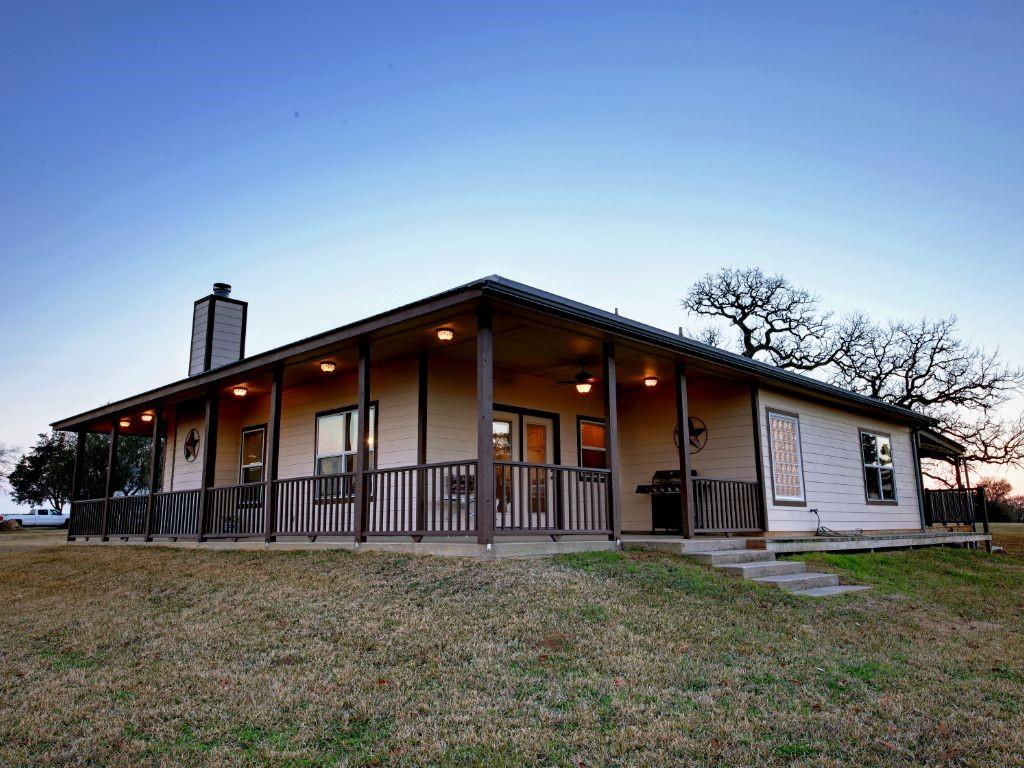 RELAX & ENJOY QUIET COUNTRY LIVING ON 34+ ACRES (approx. 25 acres plus other improvements added from the original listing) AND WONDERFUL 360 DEGREE VIEWS! THIS WELL MAINTAINED HOME FEATURES A LARGE ISLAND KITCHEN WITH ABUNDANT COUNTER/CABINET SPACE*WALK-IN PANTRY*OPEN FLOOR PLAN WITH LOTS OF WINDOWS/2-BLINDS*4 CFANS*GREAT MASTER SUITE WITH W-I SHOWER AND W-I CLOSET AND ACCESS TO WRAPAROUND COVERED DECK/HOT TUB*GARAGE EASILY CONVERTIBLE TO EXTRA BEDROOMS/LIVING (seller has begun the converting to add two bedrooms and 420 SF)*26X20 CARPORT*40X40 METAL BLDG/WORKSHOP/GARAGE WITH TWO OVERHEAD DOORS & 40X20 CARPORT/COVERED PATIO WITH ELECTRIC/WATER*20X18 METAL BUILDING/WORKSHOP WITH SPRAY FOAM INSULATION ON SLAB & ELECTRIC & WATER*GARAGE DOOR OPENER*TANKLESS WATER HEATER*MUD & UTILITY ROOMS*WILDLIFE*TILLABLE ACREAGE OR BRING YOUR LIVESTOCK OR BUILD A BIG POND*SMALL POND ON BACK RIGHT OF PROPERTY*10-15 MINUTES EAST TO GIDDINGS*NEW SEPTIC SYSTEM*VERY VERSATILE PROPERTY...BUILD ANOTHER MAIN HOME AND MOVE IN-LAWS IN CURRENT HOME*