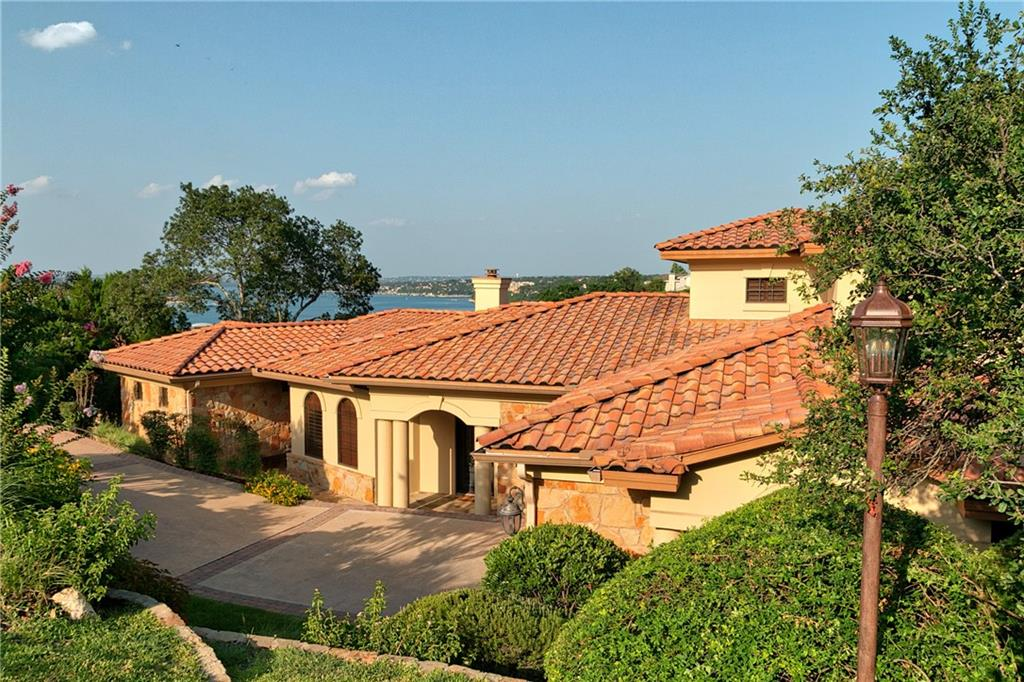 """Lakeway Luxury with Stunning Lake Travis Views!  It is a perfect """"lock and leave"""" home for you to escape to for peace and tranquility.  As a second home for the current and previous owner, it is barely lived in and never been a primary residence.  The sweeping views of Lake Travis are the first thing you see when you walk through the beautiful iron front door and into the family room with tall, wood beamed ceilings on the main level.  It is a perfect entertainer's home with a large kitchen open to the family room with two islands, granite counters and stainless steel appliances.  The family room has double sliding doors leading out to a balcony that runs along the back of the home. The oversized master bedroom has doors leading out the the balcony as well with perfect lake views.  On the lower level there are three bedrooms, two full bathrooms, a living room with a wet bar and a media room.  The fifth bedroom is on the upper floor with a full bathroom.  This is a one of kind home in Old Lakeway that you don't want to miss!  Please check out the 3D Virtual Tour at http://listing.austin360photography.com/bt/807_Mariner.html"""