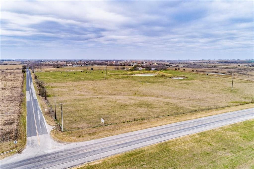 35.39 acres with approximately 1,040 ft of road frontage on FM 973 N and 1430 ft on Steger Ln. in rapidly growing Pflugerville ETJ. Located on a very busy corner, this land doesn't have any restrictions. Very usable, subdividable, buildable land down the street from the new Amazon building. Current home site sits up on a hill offering panoramic views. Capitol expansion plans include wastewater services on Steger Ln, Lift Station on New Sweden Rd in the 2025- 2029 plan. Utilities are Aqua Water, Oncor Electric, AT&T phone. There is an easement on the property, see survey.