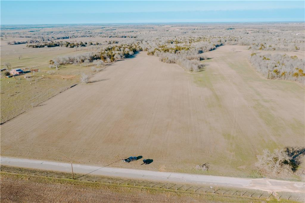 Great home building sites and locations for a stock tank if desired. Perfect multiple use property with a mix of improved coastal grass for livestock etc  and native brush for hunting whitetail deer and feral hogs. Farm exempt for low, low taxes. Electricity and SW Milam water meter available. 600 Ft of road frontage with NO RESTRICTIONS. Great Thorndale ISD schools. Seller is not retaining minerals.  New survey needed. Closing at LONGHORN TITLE-Taylor.