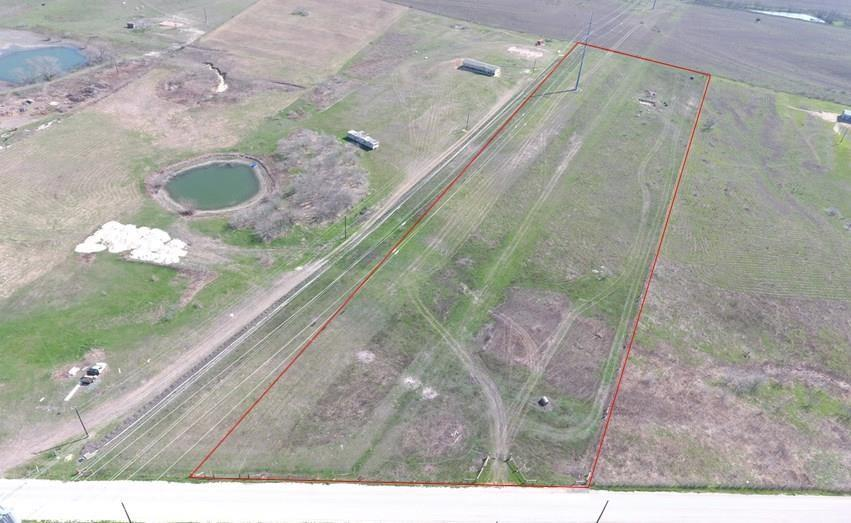 LOCATION! Only 3 Miles from I-35! Land like this is super hard to find. Fully fenced 8.37 acres with a nice hilltop view located less than 5 minutes from Buda and Kyle. Fast and easy commute to Austin in less than 10 minutes! No flood plain! Can be used as residential or commercial. Must go through City for platting. Creedmoor water meter included. Electric transmission line and gas line do go through property. Mobile homes are allowed. Outside city limits but within the ETJ. Buyer is responsible for all due diligence.