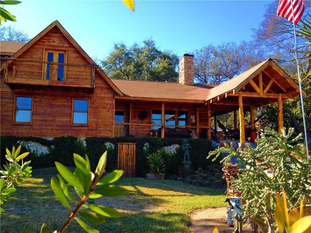 Unique Rustic Western Elegance just steps from The Austin Yacht Club! Mountain Cabin meets Lake Life! Upscale Artistic Custom-built Log Cabin with Hand Made Natural-Cedar Beams, Cedar Sliding Doors, Cedar Trim Baseboards / Mirrors / Windows, Beautiful Mesquite Flooring, Great Room, Unique Western Art Chandeliers, Slate Counters/Flooring Bathrooms/Bar Area, Quartzite Slab Kitchen Counters, Copper Bathtubs, Cozy Rock Fireplaces, Recessed Cedar Ceilings, Beveled Mahogany French Doors & Gorgeous Landscaping. Two large Master Suites with Over-Sized Bathrooms. Great for Entertaining or Relaxing! Lake Living Lifestyle!  Truly One of a Kind Custom Rustic Masterpiece.