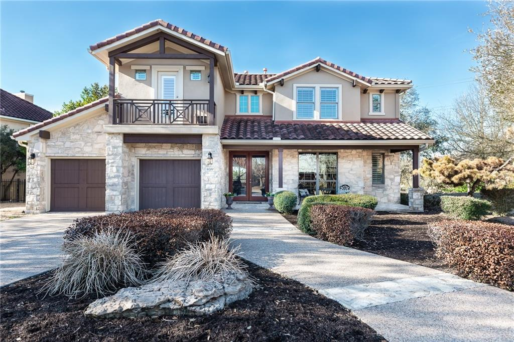 This former Taylor Morrison model was meant to showcase the best of the best. The covered front porch and balcony can make any visitor feel welcome.