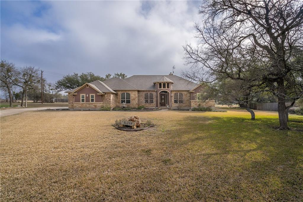 Beautiful custom home on 1.67 acres in Shady Oaks Estates. Featuring high, tray and vaulted ceilings, formal living and formal dining, wood-burning fireplace in formal living and on the outdoor patio and open floor plan.  Kitchen with granite, glass front cabinets with amazing storage, Island, Breakfast bar and open to the Family Room and the Breakfast Room.  Primary Bedroom is spacious with private office space, large walk-in closet, jetted tub, separate shower and granite.  Walk-in closets throughout.  Granite throughout.  Wood and Tile Flooring throughout.  Jack & Jill bath between bedrooms 2 & 3 with personal vanities. The fourth bedroom is the perfect guest suite with full bath just outside the bedroom.   Covered patio with outdoor fireplace and view of beautiful oak trees.  Porte-cochere leads to an amazing detached car enthusiasts' Workshop/Garage with high vaulted ceiling for auto lift and bathroom!  Cul-de-sac lot!