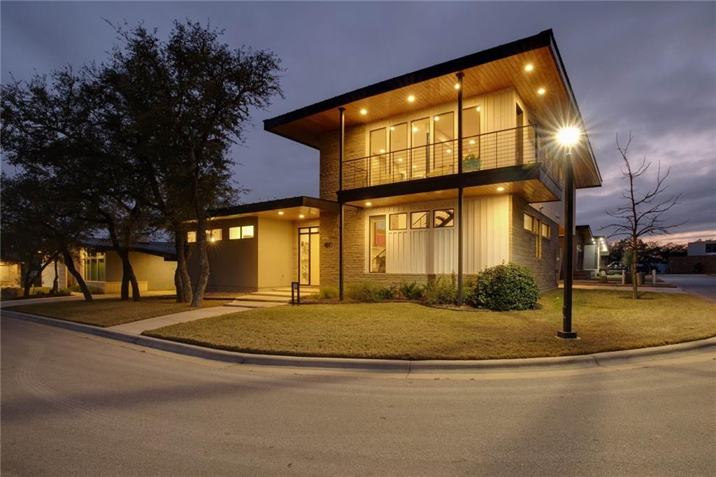 Open House Sat (03-06) from 2-4, & Sun (03-07) from 12-3. Twice presented on the Austin Modern Home Tour, '18 & '19.  Spectacular Eichler inspired Mid-Century style home featuring modern amenities is located just two miles from the Metro-Rail link to downtown Austin TX. This is a newly built, one of a kind home situated on the premiere lot in Starlight Village directly across from the Pool and Pavilion. This home features a glass entryway and spacious open living and kitchen area which is highlighted by a soaring twenty foot high ceiling and stone fireplace with a floating fire bench. The open living and kitchen area also features custom terrazzo flooring designed by the Venice Art Terrazzo Company in San Antonio and period correct Eichler style painted weldtex paneling in the dining and kitchen area. The kitchen amenities include a storage pantry, custom designer cabinetry with a fireclay backsplash and a nine foot waterfall cooking island with a stainless steel vent. The kitchen design includes overhead clerestory windows for maximum light and privacy. Other features include a beautiful hand crafted walnut floating staircase, gorgeous tongue and groove wooden soffits, an entertainment loft above the kitchen as well as two covered upstairs balconies and a first floor Ipe sun deck. The master bedroom is located in a separate first floor wing that includes a walk in glass shower, dual vanity, and spacious walk in closet. Modern amenities include energy efficient heating and cooling systems, tank-less water heaters, as well as a whole home entertainment system with 12 overhead speakers located throughout the home. Starlight Village has been featured in Atomic Ranch Magazine as well as House Hunters International.