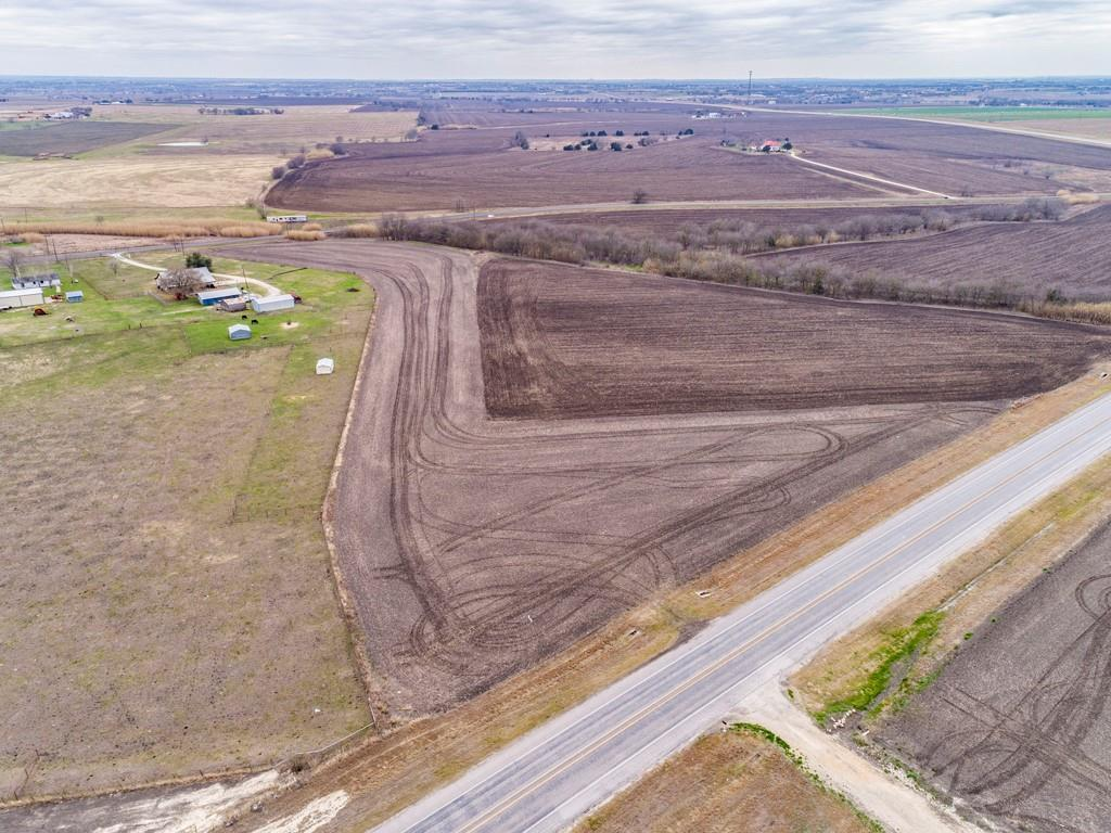 Excellent development opportunity in Pflugerville ETJ. Ideal location on rapidly growing FM 973 between Rice's Crossing and FM 290. No restrictions, any minerals owned by sellers convey. Aqua Water & AT&T Phone available at road, Oncor Electricity Available. Approximately 516 ft. of road frontage on 973, and additional road frontage on Walton Hill Pass.