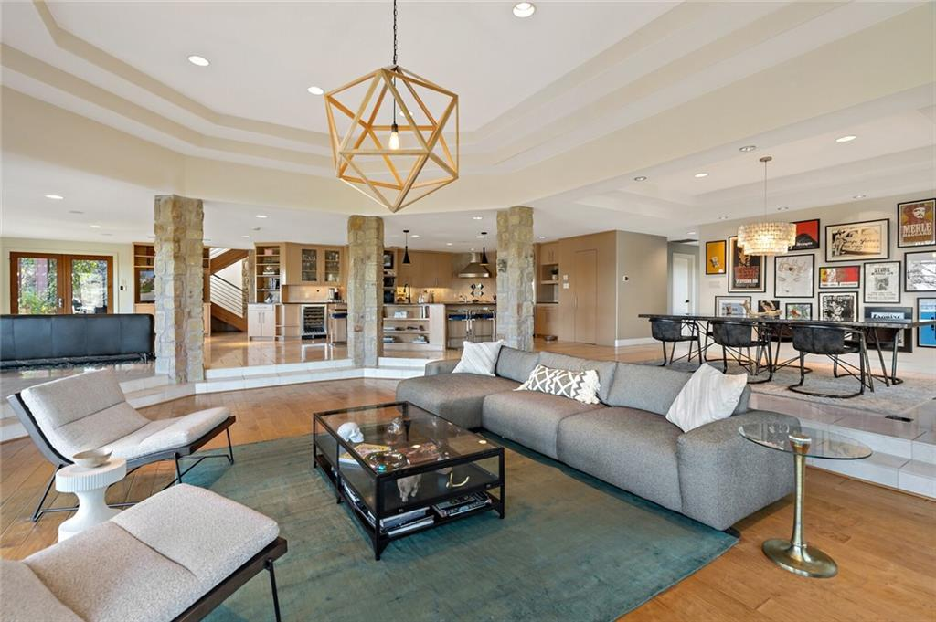 Austin ETJ & no HOA. Beautiful canyon, hill country, and/or downtown Austin views can be enjoyed from the open and bright living areas and ipe pool deck. Some of Austin's most exclusive multi-million dollar properties surround you along with sounds of nature and an entrance to the Wild Basin Preserve within walking distance.  The extremely flexible floorplan allows for multi-generational living with two owner suites, multiple living areas, and plenty of outdoor spaces for al fresco dining underneath a terrace, kicking around a soccer ball on flat grassy areas, or roasting marshmallows around the natural fire pit. The laid back contemporary style is welcoming and warm, and the current owners have updated in a chic fashion including the owner suite with fireplace, reimagined bathroom with steam shower, and boutique-style closet. While it will be a perfect match for many, some may want to explore tweaking the property to take advantage of even more expansive downtown views at some point in time.  Many updates to the open and bright kitchen include upgraded appliances, a wine refrigerator, and a built-in coffee maker. The recent addition of an 8+ vehicle car barn with oversized garage doors large enough to store boats, RVs, and/or lifts for additional car storage. This structure also houses an office and gym with the potential to add 1-2 BDRMs and a bathroom, with upgraded septic to accommodate.   Exemplary Eanes ISD and only ~10 minutes to downtown Austin. This hidden gem oozes with a cool Austin vibe that's innocuous and understated from the outside, but unique and energetic on the inside.
