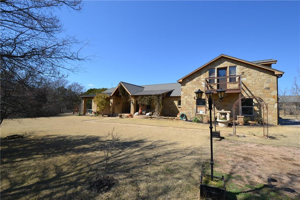 Gated subdivision, house and separate guest house on 5.62 wooded acres with access to 3 acre park on Bear Creek.