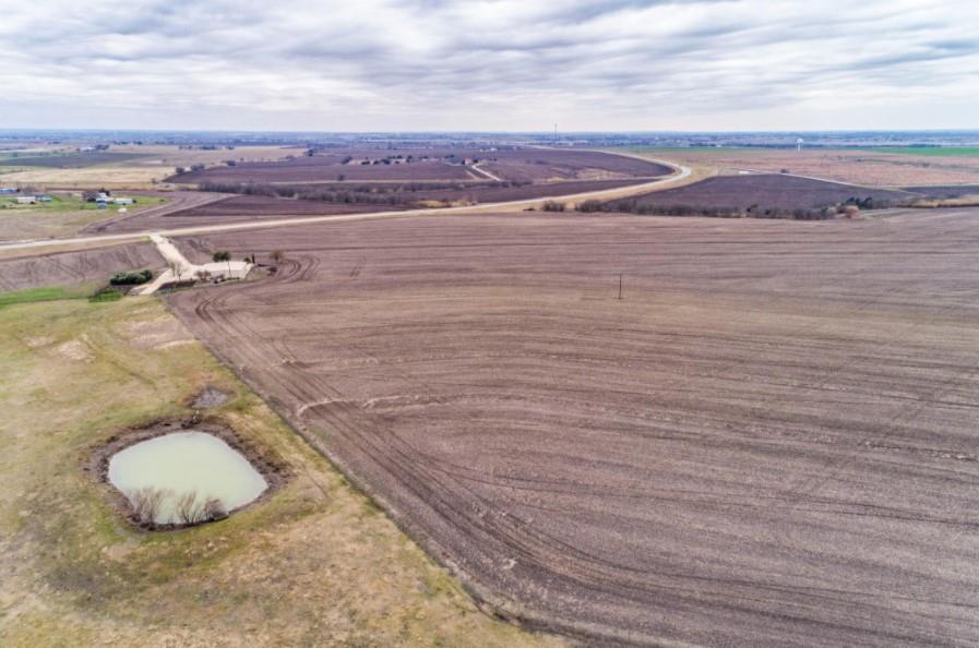 Excellent development subdivision opportunity in Pflugerville ETJ. Ideal location on rapidly growing FM 973 between Rice's Crossing and FM 290. No restrictions, any minerals owned by sellers convey. Rolling topography, panoramic views, wet weather creek and pond, floodplain along northeast boundary. Aqua Water & Oncor Electricity on site, AT&T available at road.