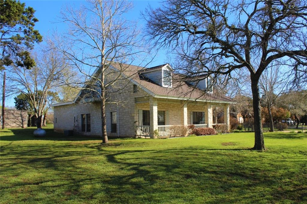 Come see this Texas Stone Home (100% all 4 sides stone) on 1.89 Acres, enjoy country living with a short 10 min drive to tolls and shopping. This is a large home situated in a small neighborhood tucked away from the hustle and bustle. Home offers a large yard, workshop and  storage buildings and inground Gunite pool completely fenced with its own tiki hut and over 2000 sq-ft of patio to entertain or just to relax.  The home has 3 nice sized bedrooms, 2 full baths and 1-1/2 bath ,a living room, kitchen and main area has Texas Granite floors, family room, office and so much more. The trees are all mature Oak and Elm trees as well as a garden area and chicken coop.