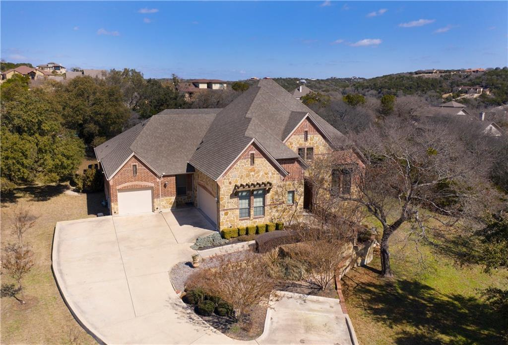 Come enjoy this wonderful home in the gated golf course community of Grand Mesa at Crystal Falls! Beautiful views of the amazing rolling hills in the Texas Hill Country can be seen from every corner of this home while being tucked away on a little over an acre at the end of the cul-de-sac. This home offers a very spacious primary bedroom with lighted tray ceilings, a great seating area, and hardwood floors. Step into the primary bathroom for a spa-like experience with a separate walk-in shower and soaking tub. Make your way into the primary closet to find the hidden gem behind the bookcase! This flex space would be perfect for a second office, nursery, workout room, craft room, or many other solutions. While making your way back through the rest of the home you will find two spacious secondary bedrooms with adjoining bathrooms for each room. Become the chef that you have always wanted to be in this gourmet kitchen that offers stainless steel appliances throughout, double gas ovens, dual sinks, an enormous amount of storage, and counter space! Once you have finished your 5-star meal, relax and unwind while watching your favorite movie or sporting event in the large media room. Then curl up next to the fire on the back patio either by the outdoor fireplace or firepit to do a little star gazing in the big Texas sky. This home has plenty of space to add that refreshing pool that you have always wanted. While you may not want to leave your private oasis, this home is nestled in the award-winning Leander ISD, in the golf course community of Crystal Falls, and just minutes from great shopping.