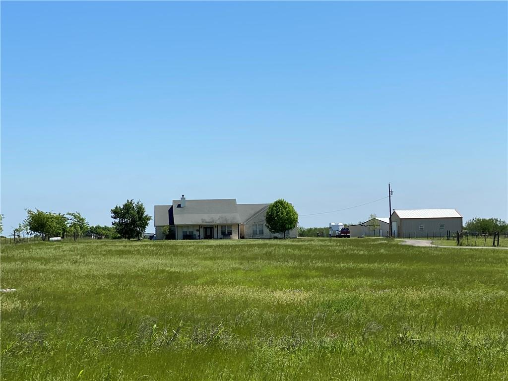 Located less than 4 miles east of I-35 and the Round Rock Outlet Mall, this wonderful horse property on 12 acres in south Georgetown is a rare find.  This 4 bedroom, 2 1/2 bath home has something for everyone!   With an open floorplan, ceramic tile and wood flooring, granite countertops, center island with cooktop, a large pantry, huge family room, spacious Master, an oversized 2 1/2 car garage, porches front and rear and a 20,000 gallon in ground swimming pool,  this hard to find property is truly a gem!  You can use the 4th bedroom as a bonus room - it's big enough for a regulation sized pool table and has direct access to the back porch and pool area.  Easy access to I-35 and the 130 Toll road makes your commute a breeze!