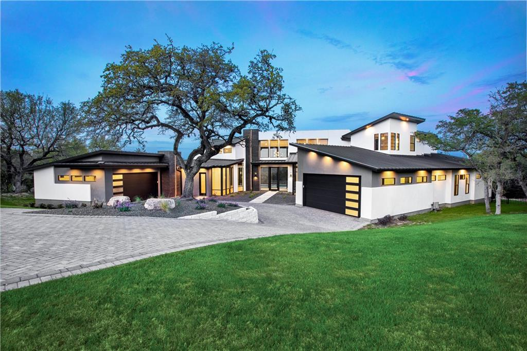 Sleek contemporary new build in an exclusive gated Lakeway neighborhood of just eight custom homes .  Enjoy the lake lifestyle just minutes away from Hurst Harbor Marina, while also accessing shopping and entertainment in Bee Caves.  Created for outdoor living, the 1 acre property features a dramatic limestone-surrounded pool, several covered patios, a summer kitchen and a sunken fire pit for chilly evenings. 