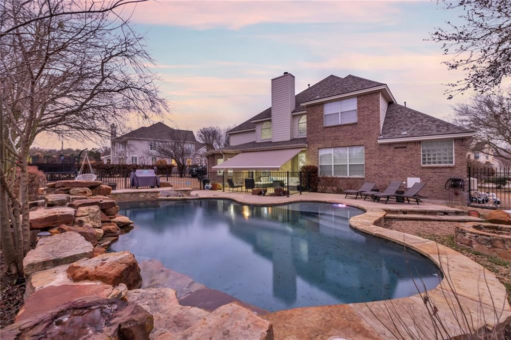 No showings until March 13th and 14th. Beautiful Toll Brothers 2 story home, on Hamlet Circle in Forest Creek! Amazing pool with waterfall and oversized yard backing to the golf course! 5 bedroom home with 2 beds down and 3.5 baths plus gigantic game room. Huge open kitchen with walk in pantry and tons of cabinet and counter space! Wood floors, lots of natural light and modern gray paint. New Roof (labor Transferable),new interior paint including ceilings, Epoxy garage, Home is a combination of brick and large River stone which makes it seem like an English countryside home. New AC unit and New water heaters. Top of the line schools, golf course community with great amenities. Tenant in the property that needs to finish lease.