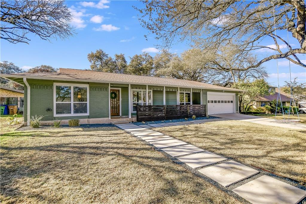 Beautifully Remodeled Single-Story with Lavish Features Throughout! Nestled on a quiet & friendly cul-de-sac street, have the best of both worlds by living minutes to shopping & eateries at The Domain, The Arboretum, & Downtown. Only 3-blocks from one of the highest-rated public elementary schools in Austin. Open the front door & instantly feel at home as you step inside the open-concept floorplan & are surrounded by gleaming wood floors, stylish lighting in the formal dining room, & high ceilings throughout with recessed lighting. With a beautiful wall of built-ins & an abundance of natural light, unwind with your guests in the spacious living room & get cozy next to the floor-to-ceiling fireplace with herringbone tile. The fresh & modern kitchen is an entertainer's dream as it opens to the living room & dining area & boasts sleek Quartz counters, a large center island with bar seating, a gas stovetop, a SS built-in oven, & Shaker cabinetry. Right off of the dining area & kitchen is a sweet office nook with floating shelves & a shiplap accent wall - great for those who work from home. Retreat to your dreamy primary suite that is full of light & sure to please with its high beamed ceiling & its sliding barn door that leads you into the spa-like bath with dual vanity, separate shower/tub, & a walk-in shower. The home is complete with a mother-in-law guest suite with a private bath, two secondary bedrooms, & a 3rd full bathroom. Enjoy the shade under the gorgeous mature trees in the huge backyard & lounge back on the expansive deck that is perfectly suited for all your outdoor dining & entertaining needs!