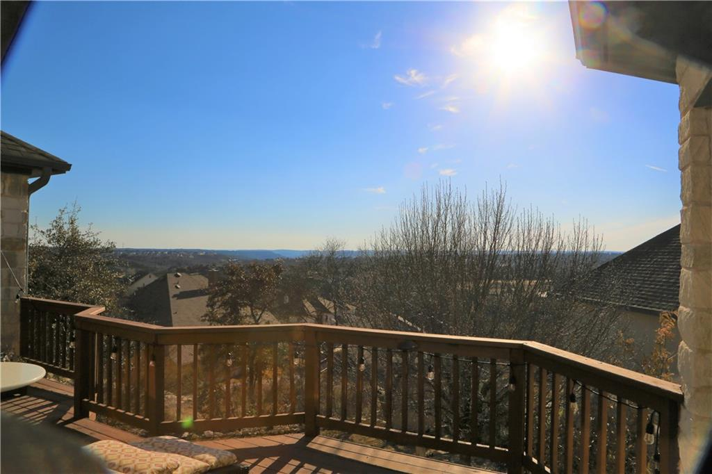 Beautiful view from the back deck of this beautiful 5 bed custom home in a gated section of Chrystal Falls subdivision.  Panoramic view of golf and hill country.  Floor to ceiling stone on formal dining, kitchen  and up stairs game room. Detached 3rd car garage with breezeway.    Large master bed with sitting area and door to back deck.  Covered outdoor patio and built in fireplace and water feature.  Spacious bedrooms up with gameroom between.  Built in desk.  One room converted to media room for your viewing pleasure. This home allows gazing off to the horizon from one of the highest points in the area from the back deck.