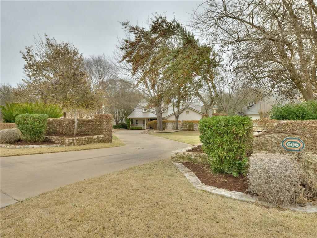 """Own this rare 1-story home in Lohman's Crossing of Lakeway on 1 acre lot, with private gate access to Lakeway City Park. This 4bed/3.5bath home has many ideal features including large study, open kitchen-breakfast-family room with vaulted ceilings, screened back porch, metal roof, solar panels. 36"""" doorways & wider hallways. Original owners!  Amenities include: 7 acre park on Hurst Creek arm of Lake Travis, day dock, private boat ramp, 2 tennis courts, & swimming pool."""