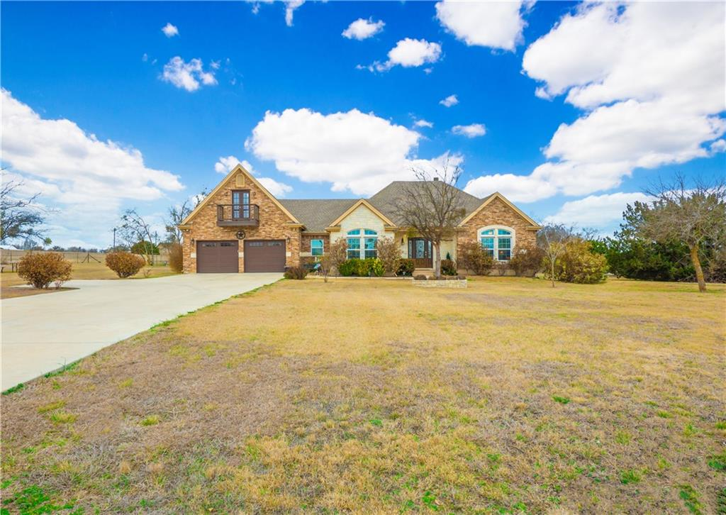 Stunning, custom built home on 1.5 acres. This home will amaze you with it's tall ceilings, crown molding and beautiful wood flooring. The gourmet kitchen will be delight for any cook with its granite counters, pendant lighting, electric cooktop, built-in ovens and stainless appliances. There's a formal dining area plus a cozy breakfast nook. The living area offers a corner, stone fireplace. The owner's retreat is the perfect place to unwind after a long day with a separate sitting alcove, with exit to the private patio and a built-in desk area. The owner's bath offers a luxurious jetted tub, dual vanity, walk-in shower and a spacious walk-in closet with vanity desk. Two additional bedrooms share a bath with dual vanity and granite counters. Upstairs you'll find the perfect hobby or media room with its own private bath and balcony. Views for miles from your back deck!