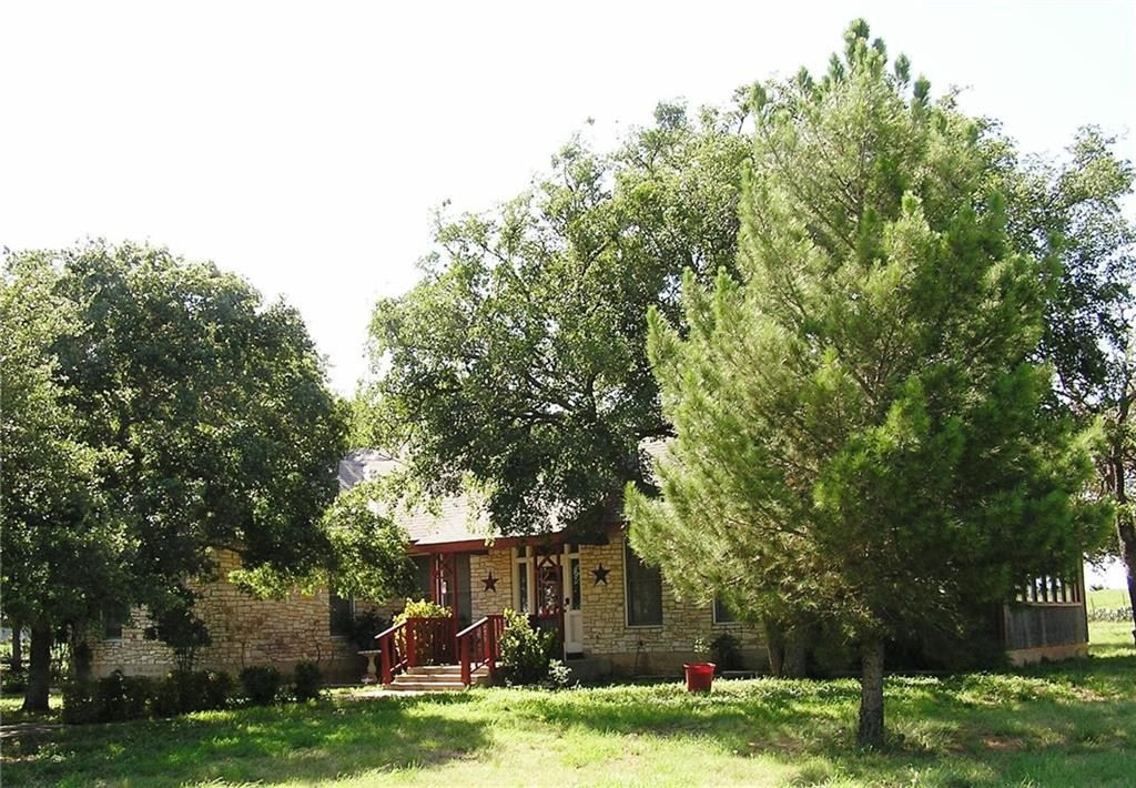 Located on the eastern edge of Burnet, this 88 acre tract has approximately 700 feet of frontage on Hwy 29. 1,728 sq. ft. house, garage, workshop, corrals and barn. This property offers a wide range of potential uses. The extremely level terrain is ideal for commercial or residential development or a mix thereof.   Buyer's agent must be identified on first contact and must accompany buyer on first showing