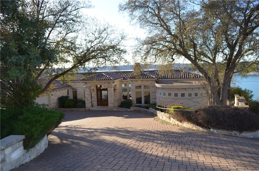 """BREATHTAKING PANORAMIC VIEWS of Lake Travis & the Texas Hill Country! 5268 sq.ft. 5 bed/7 bath Estate home on the main body of water w/private boat dock. So many special features include Infinity edge pool, pool bath/kitchenette, elevator, tram, fire pit & more!  Majority of contents of house will convey, making this a perfect 2nd home, ready to move in ASAP for upcoming spring/summer enjoyment on Lake Travis! Home will be sold """"as is"""". No seller repairs w/exception to repairs currently in process from minimal damage due to pipe bursting due to freeze."""