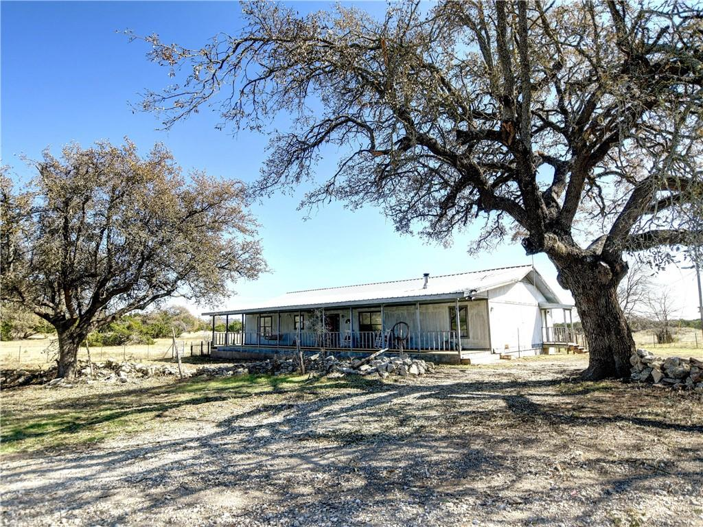 Step into a private and peaceful country living! Situated in a desirable Dripping Springs, Hays County! Minutes away from central Dripping Springs and easy access to Downtown Austin. Close to highly acclaimed Dripping Springs ISD schools. Huge lot with tons of possibilities. Home boasts an oversized living room, large kitchen and dining room, peaceful and huge bedrooms. Master bedroom has his and hers closet. Property includes a 3 stall barn perfect for animals and/or for additional storage. Covered porch for you to enjoy your morning coffee or your evening relaxation. Buyers have a lot of opportunities to make with this huge lot. Enjoy that country living and bring your offers now!