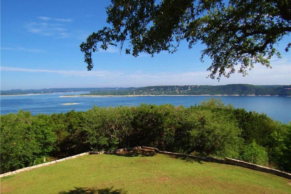 "LAKEVIEW of beautifully blue Lake Travis! 180 degree view of Lake Travis in glass-walled house!  ""Going, Going, Gone!"" are the houses with beautiful views of the main basin of this blue, blue lake.  Large and private property.  Custom baths and kitchen.  One mile from marina.  15 minutes to downtown Austin.  Has slept 14 when used as VRBO.  (House has loft that could hold 2 queen beds, and 2 bedrooms are large enough for 2 queen beds each.)  Lake views from living room, dining room, kitchen, breakfast room, loft, bedrooms."