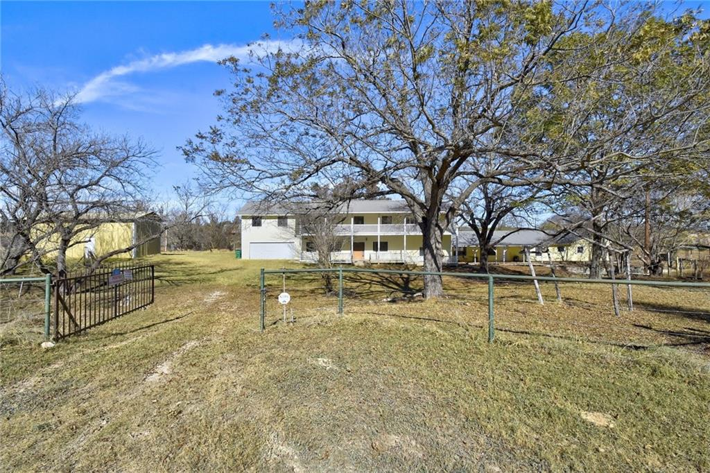 Stellar Investment Opportunity! Sweat equity beckons from this UNRESTRICTED 17+/- acre with 1200'+/- feet of Miller Creek just 40 minutes to Austin. 5150+/- sf 2 story ranch style main dwelling features a recently remodeled first floor with expansive living areas and original second story showcasing 2 oversized bedrooms needing some TLC. Gorgeous wooded areas featuring mature pecan and oaks trees encircle a grassy meadow grazed by native wildlife. Ideal for communal or multi-generation living, but needing work. Hunting allowed. Currently wildlife-exempt. Flooding in 2018.