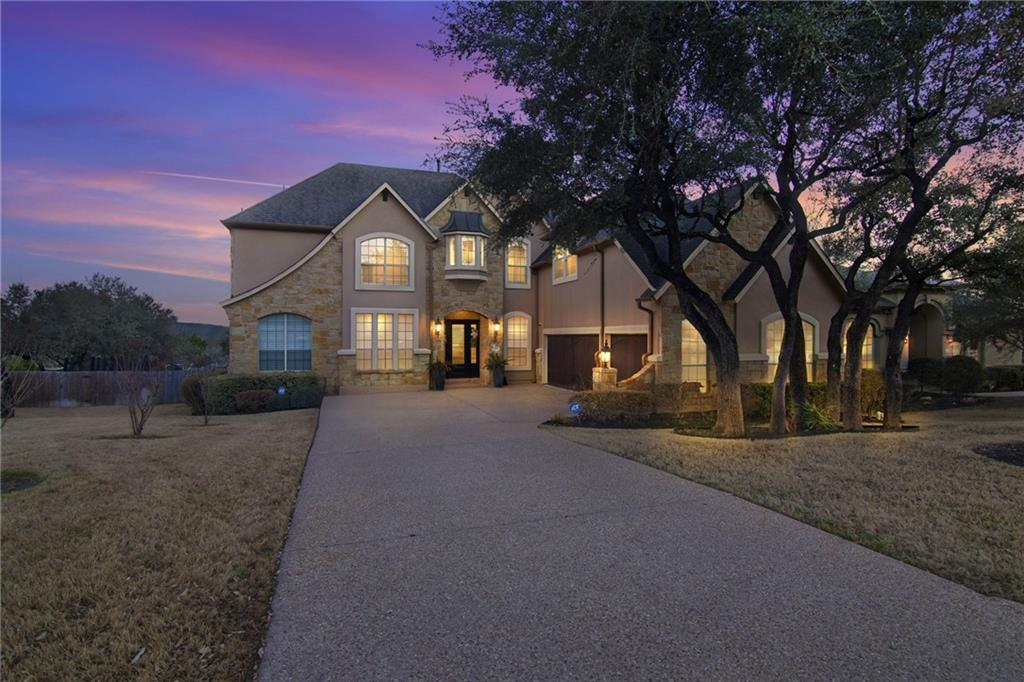 This Steiner Ranch home is complete with an extensive renovation and over $120,000 of improvements. It sits on one of the larger level lots in Emerald Ridge. The lower level opens up to a spacious gathering room with a fireplace and views of the pool and expansive backyard. The kitchen features quartz countertops and a layout suited for family gatherings and entertaining. Other lower-level spaces include the dining room, a dedicated workspace, a guest bedroom, and a full bathroom outside the door. The owner's suite has a view of the backyard, and the owner's bath with dual vanities, separate shower, and stand-alone tub will have you feeling like you escaped to a day at the spa. The upper level opens up to a game room and an enclosed media room. There are two bedrooms with a full bathroom between them. The back bedroom has access to the upper balcony overlooking the pool and hill country. Past the game room are two more bedrooms connected with a jack and jill bathroom. The floorplan is complete with four bedrooms and two full bathrooms upstairs, and two bedrooms with two full bathrooms downstairs. The three-car garage will provide you with plenty of space for cars and extra storage. Step outside for a relaxing day around the pool and a backyard with room to roam. The northwest orientation is ideal for morning sun and evening shade. Make it yours.