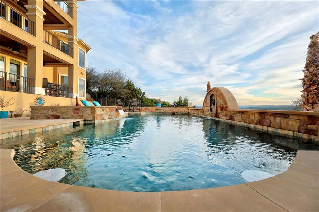 Sitting on over one-half acre, this house has incredible panoramic views of Lake Austin and the surrounding hill country.  Resort-style living awaits with a Roman-style pool and hot tub, with swim-up bar seating.  Three levels of covered patios/balconies, and a fourth covered patio adjacent the pool and overlooking the outdoor stone fireplace.  Large yard for games and sports.  This house features two offices on the main level; and an exercise room overlooking the pool and Lake Austin, a tiered media room, and second kitchen on the lower level.  Located on a private drive in River Heights Overlook gated community, within walking distance of elementary and middle schools.