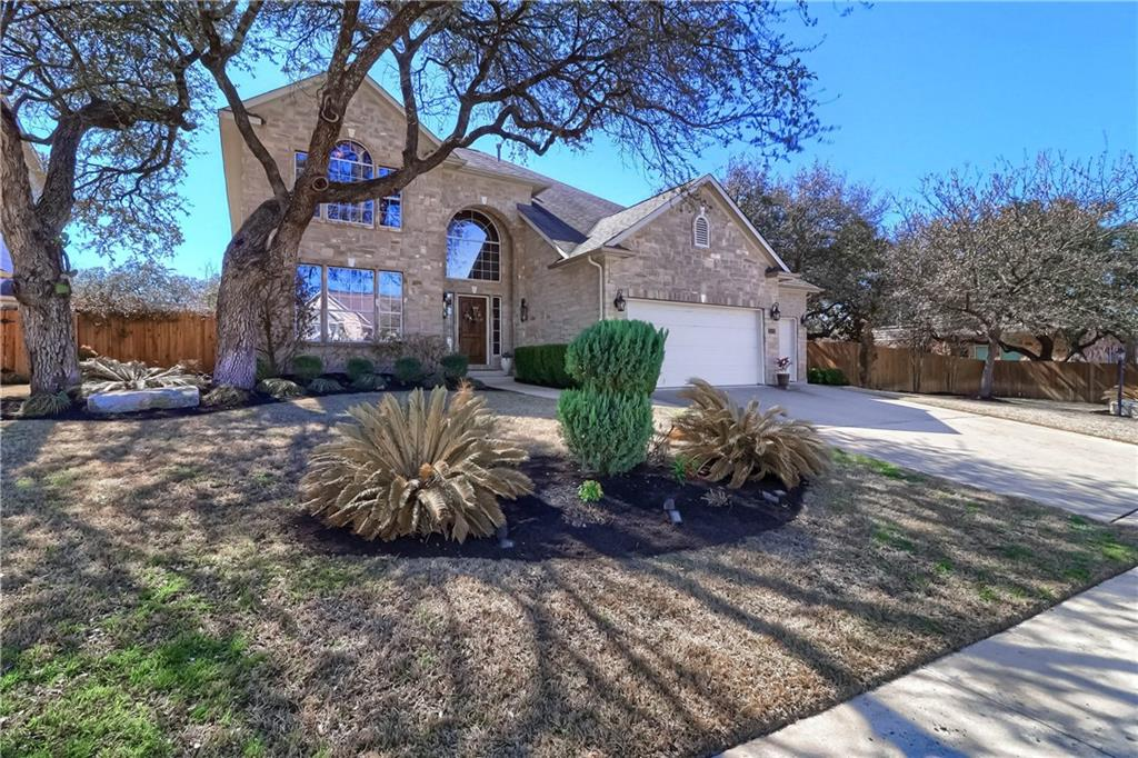 This gorgeous home sits on a huge, 1/3 acre lot featuring tons of amenities! The spacious and thoughtful floor plan provide ample room for entertaining or simply relaxing. With views to the backyard and full of natural light, the living room opens to the large kitchen, breakfast area and bonus nook. The kitchen features a stainless appliances including gas range, oven, microwave & provides tons of cabinet/counter space. Main bedroom is located on the first level w/ensuite bath that includes garden tub and separate walk-in shower. All secondary beds are up and located off the large second story living area/flex space. Upon entering the backyard, you'll find an oasis of shade trees that includes a pergola covered hot tub, an outdoor kitchen area complete with grill, beverage cooler, and bar that all sit on a beautiful stone patio. Additionally there is a cozy, screened-in porch and still tons of yard to play! On top of all of this, Steiner Ranch amenities are seemingly endless with community centers, multiple pools and splash pad, 20 miles of hiking/biking trails, tennis/basketball courts, community events, boat ramp and lake access. Don't miss this gem before it's gone!